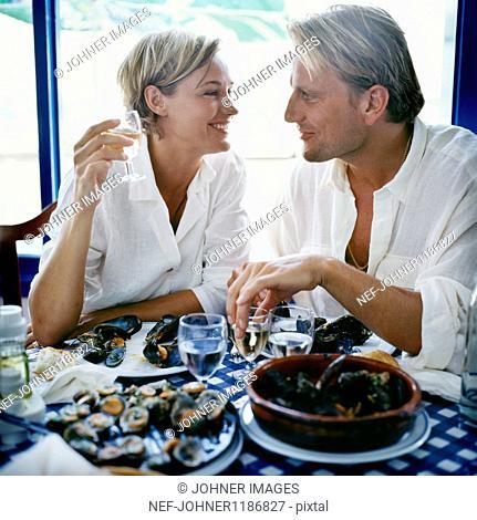 Couple eating seafood