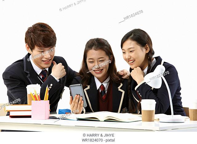 Three students having fun together