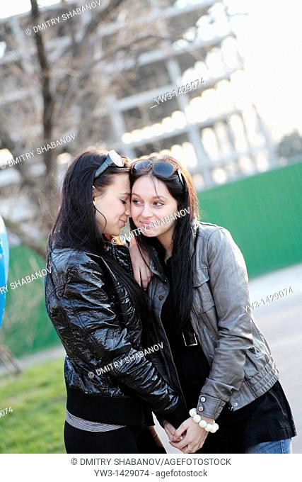 two beautiful brunette together outdoor portrait