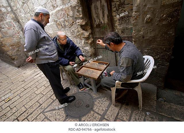 Men playing Backgammon Arabian Quarter old part of Jerusalem Israel