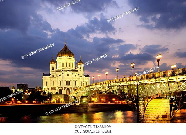 View of Cathedral of Christ the Saviour and Patriarshy Bridge over Moskva river at night, Moscow, Russia