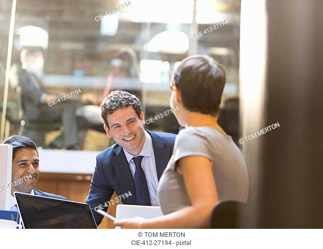 Smiling business people working in office