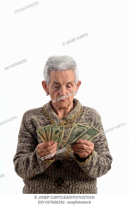 Old woman counting banknotes
