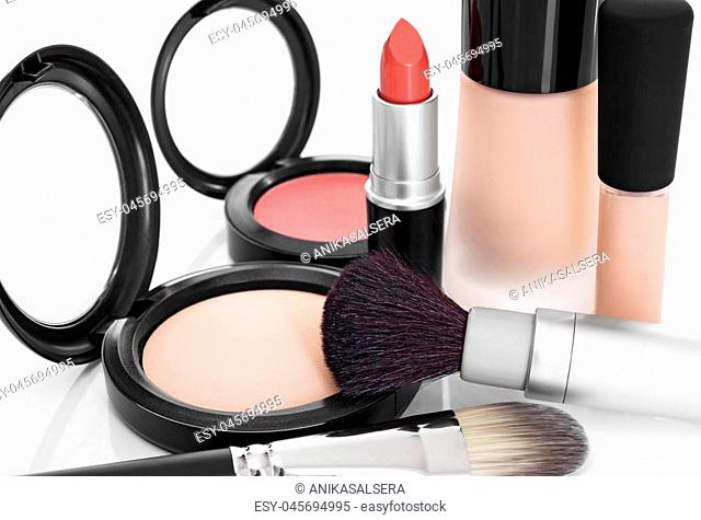 Elegant makeup collection. Foundation, concealer, face powder, blush, lipstick, brushes