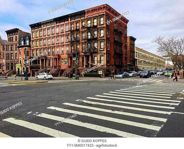 New York City, USA. Traditional and worn out Apartment building on Malcolm X Blvd, Harlem