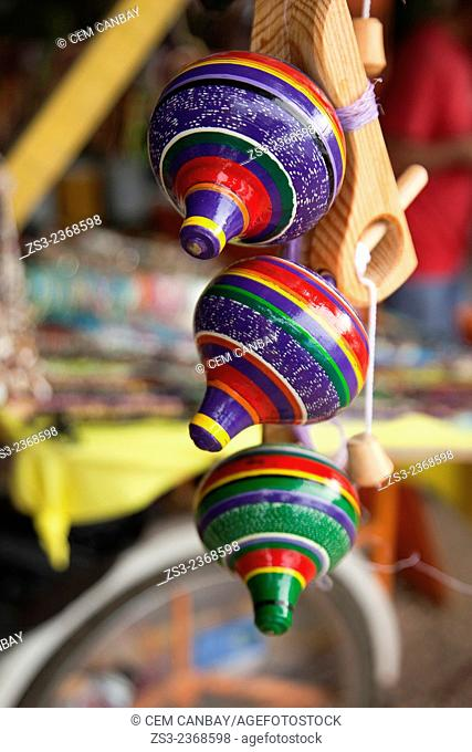 Colorful whipping tops at the market stall in town center, Isla Mujeres, Cancun, Quintana Roo, Yucatan Province, Mexico, Central America