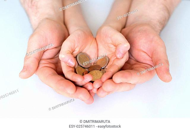 Dad and his daughter holding euro coins