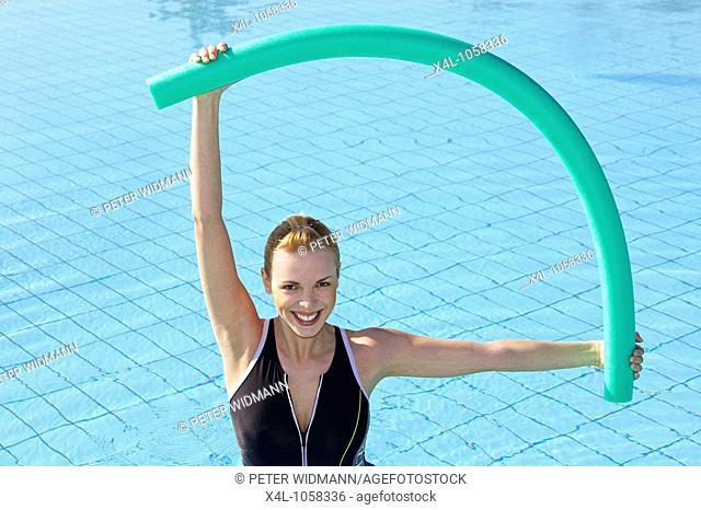 Young woman doing aquaaerobic in the swimmingpool