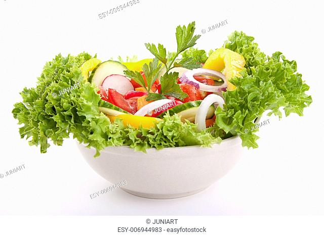fresh tasty healthy salad with different vegetables isolated on white background