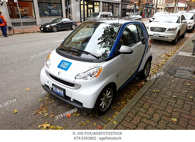 car sharing car2go electric car parked in a parking spot in downtown Vancouver BC Canada
