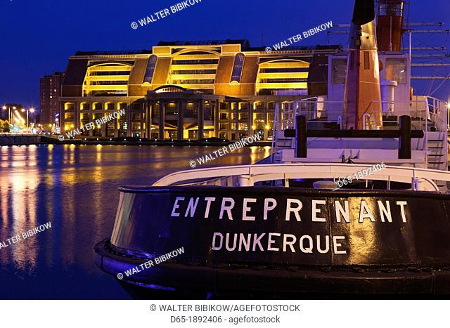 France, Nord-Pas de Calais Region, Nord Department, French Flanders Area, Dunkerque, tugboat and Comunaute Urbaine building, dusk