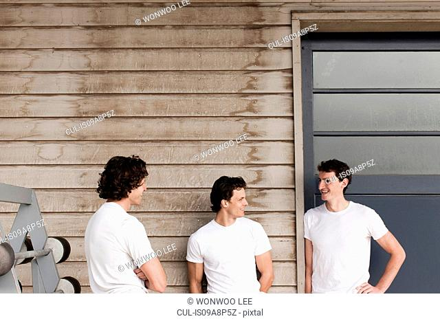 Men standing and chatting on front porch