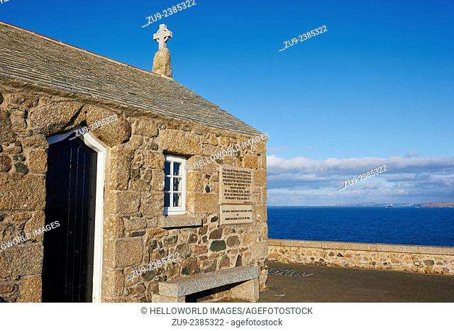 Granite Saint Nicholas Chapel with Bay of St Ives in background, Cornwall, England, Europe