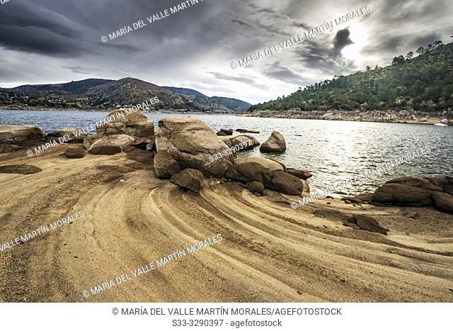 Burguillo reservoir in Iruelas Valley early in the morning on a cloudy day. Avila. Spain. Europe