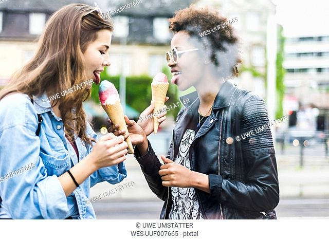 Two best friends eating icecream together