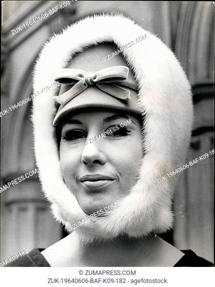 Jun. 06, 1964 - Christian Dior Hats For Autumn 1961: Photo shows. Rita Watson wears 'St. Moritz', a combination of a velvet peaked pillbox hat with a white mink...