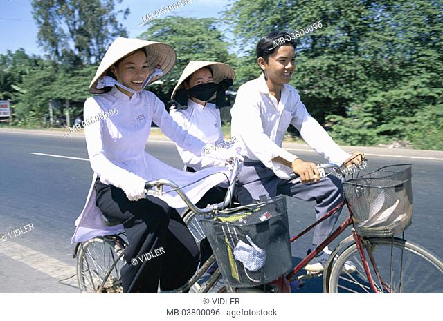 Vietnam, Mekong delta, Can Tho, Students, schoolgirls, straw hats, bicycling, Southeast Asia, natives, girls, students, Women, young, Vietnamese, two, boy, man
