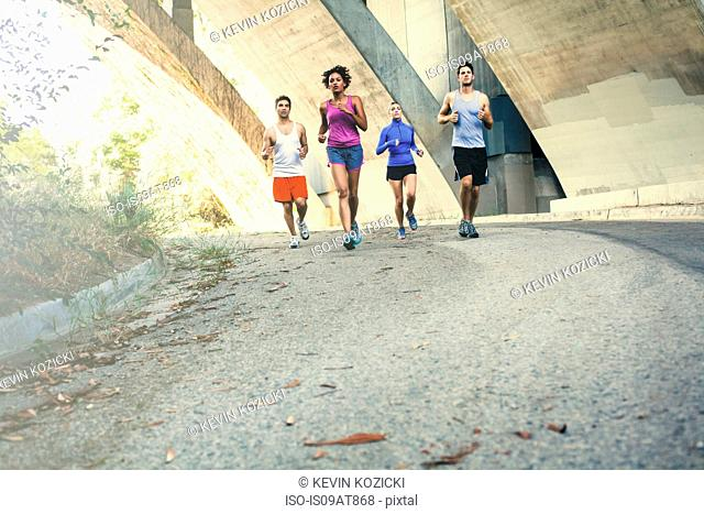 Joggers running on bridge, Arroyo Seco Park, Pasadena, California, USA