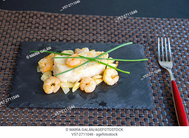 Hake loin with prawns, garlic and spring onions