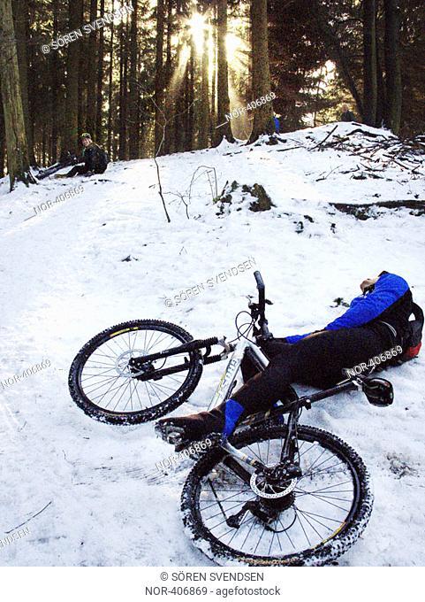 Thomas and Lasse fallen from their mountain bikes on snow, Gell Skov 2005