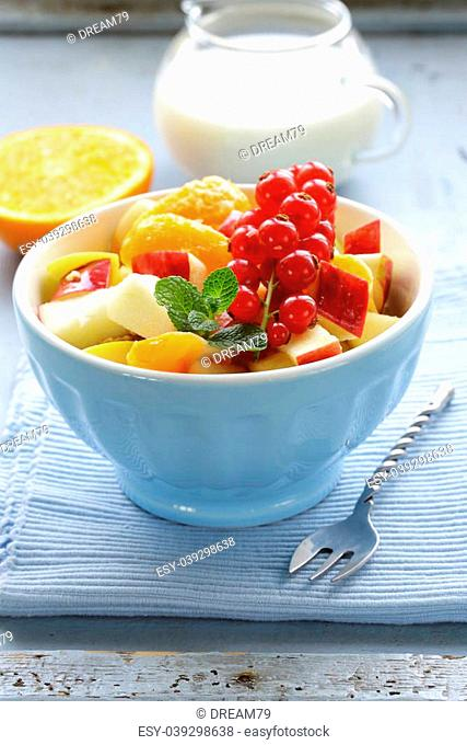 fruit salad with orange, apple and red currant