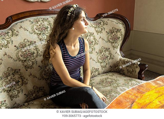 Girl sitting, Sukiennice, Cloth Hall, Krakow, Poland