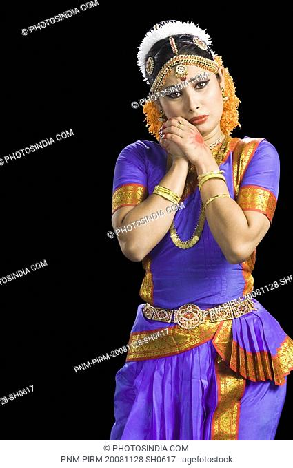 Woman performing Bharatnatyam the classical dance of India