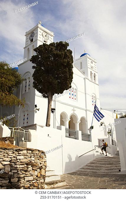 Tourist in front of the Agios Spiridonos Church in Apollonia village, Sifnos Island, Cyclades Islands, Greek Islands, Greece, Europe