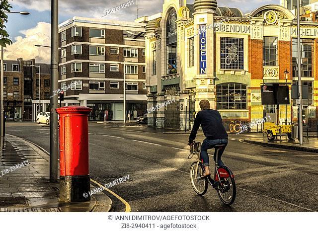 Sightseeing riding a bicycle, Bibendum,S outh Kensington,London