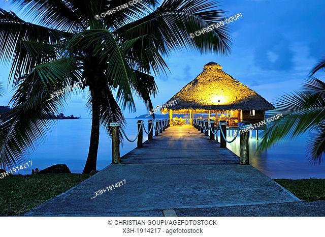 bar and restaurant on stilts at dusk, Playa Tortuga hotel, Colon Island, Bocas del Toro Archipelago, Republic of Panama, Central America