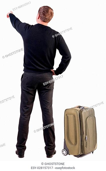 Back view of traveling business man with suitcase pointing. Rear view people collection. backside view of person. Isolated over white background