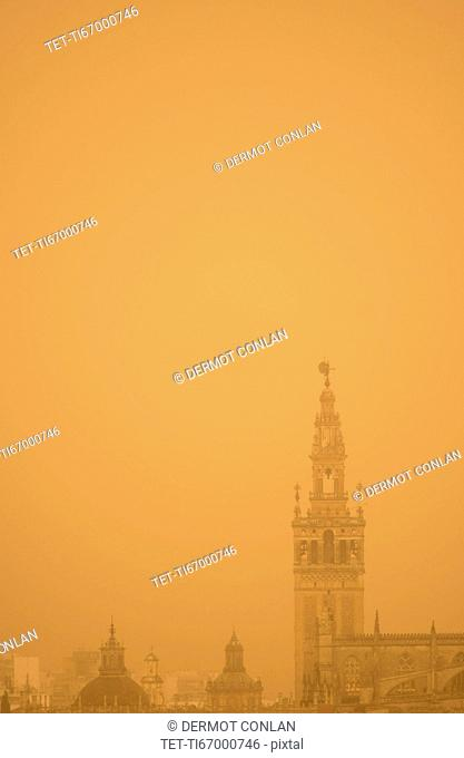 Spain, Seville, Giralda at foggy day