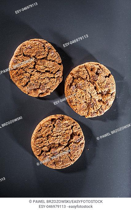 Group of chocolate cookies on a black background. Close up