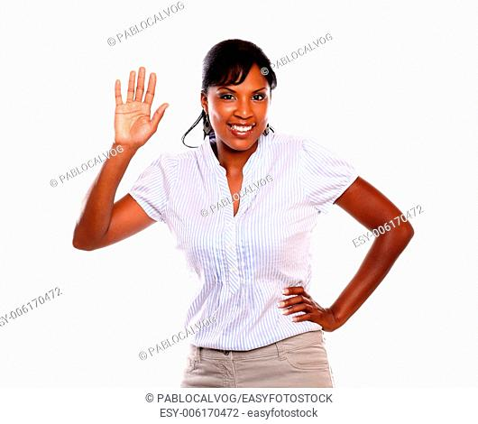 Beautiful young woman greeting at you against white background