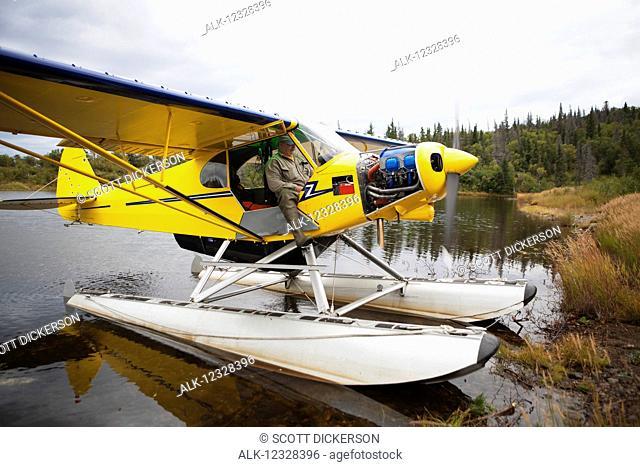 Pilot In A Piper J-3 Super Cub Beach On Lake Iliamna, Southwest Alaska, USA