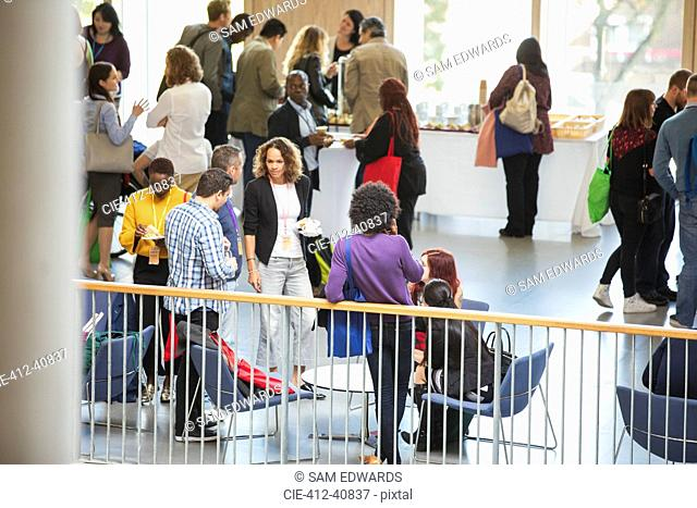 Business people networking, talking at conference