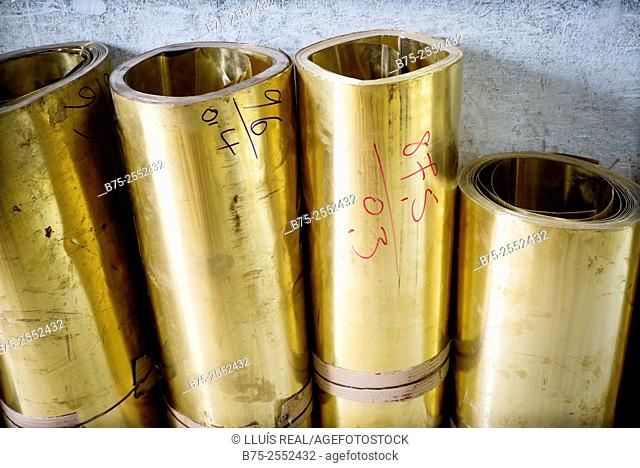 Brass rolls in a warehouse of metals in the medina of Fez, Morocco, Africa