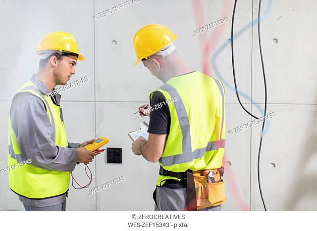 Electricians working on construction site