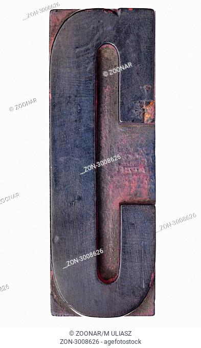 letter C - isolated antique wood letterpress printing block stained by color inks