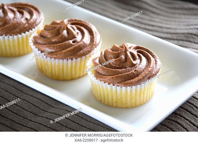 A row of chocolate cupcakes