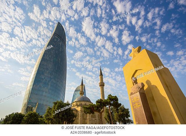Azerbaijan , Baku City,Monument to H. Aslanov at Shadhidlar Hiyabani and Flame Tower