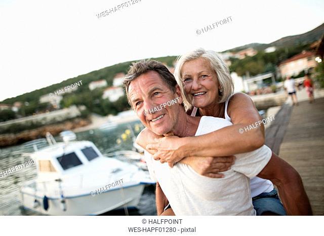 Portrait of happy senior couple on vacation