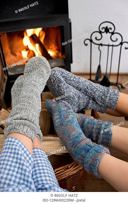 Feet warming by the fireplace
