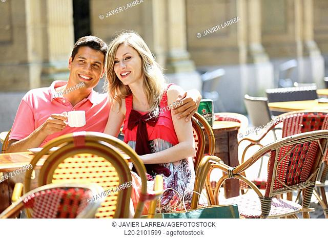 Couple drinking coffee on a terrace. San Sebastian. Donostia. Gipuzkoa. Basque Country. Spain
