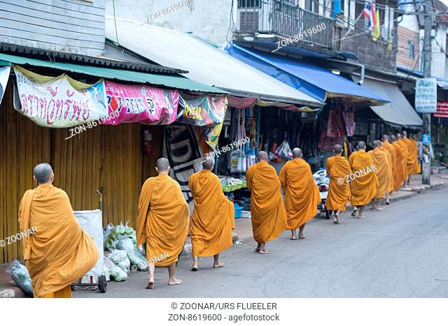 monks at the market in the Village of Thong Pha Phum north of the City of Kanchanaburi in Central Thailand in Southeastasia