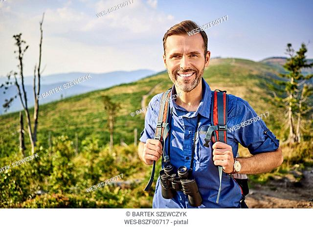 Portrait of smiling man hiking in the mountains