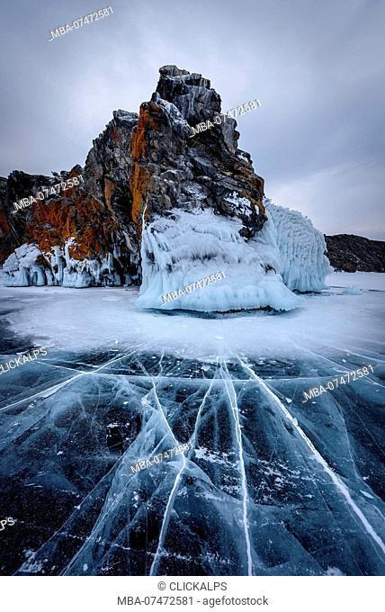 Ice cracks towards to an island at lake Baikal, Irkutsk region, Siberia, Russia