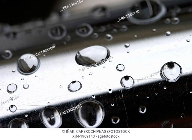 Raindrops over a metal tube