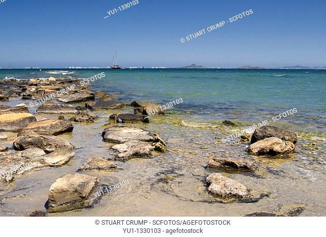 Clear blue waters of the Mar Menor lap on to the beach at Los Alcazares, Costa Calida, Murcia, Spain