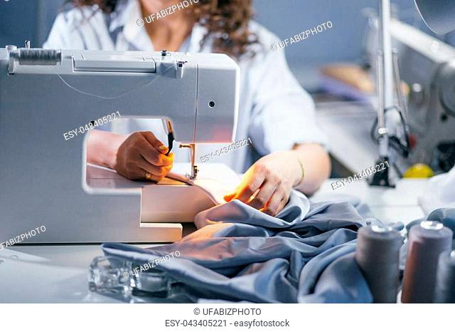 cropped closeup photo of working sewing machine. electric sewing machine